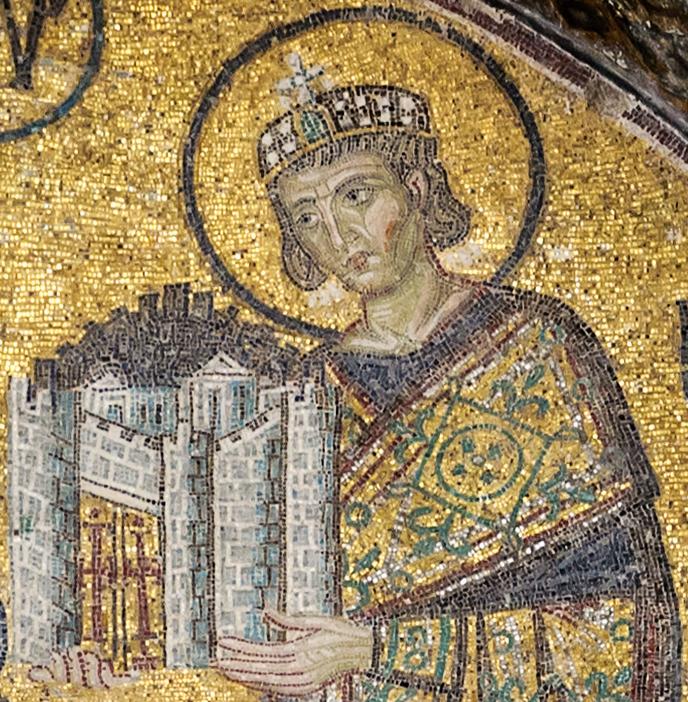Kejsaren med krona och vacker mantel håller en borg med höga vallar